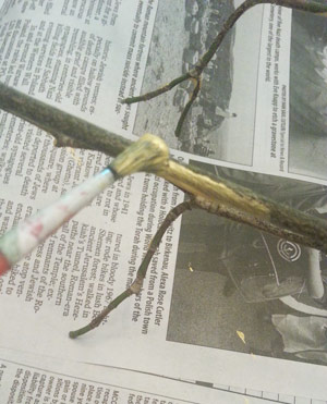 Paint the twig with gold paint