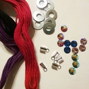 Supplies needed to make a rhinestone washer bracelet