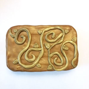 Covering an Altoid tin with oven baked clay