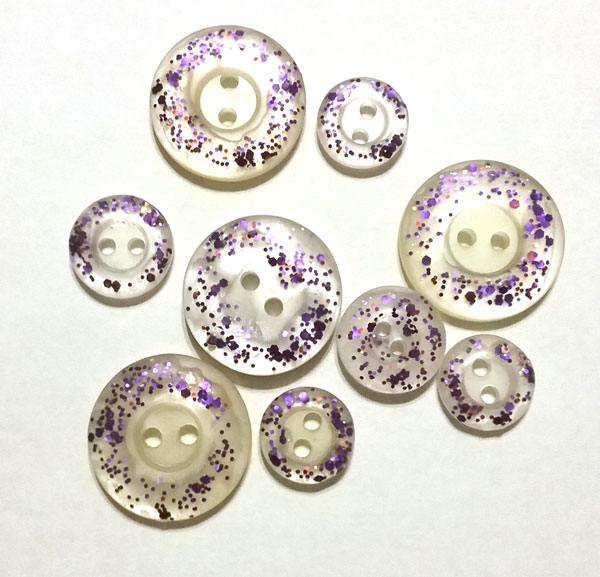 Glitter nail polish painted buttons