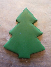 cut a Christmas tree shape out of green sculpey clay