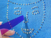 Gluing rhinestones to jacket