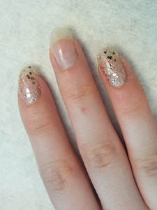 Apply base coat to nails before gluing rhinestones