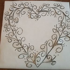 Using a template to paint on a ceramic tile