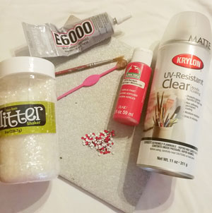 Supplies need to paint on a ceramic tile