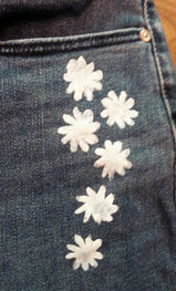 White daisies painted and jeans leg