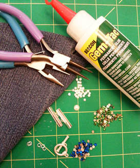 Supplies needed to make a rhinestone and denim cuff bracelet